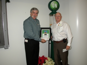 St. Mary's Food Bank Alliance CEO Terry Shannon and Bob Mahoney, ON Semiconductor Executive Vice President, Sales & Marketing and the gumball machine plaque.